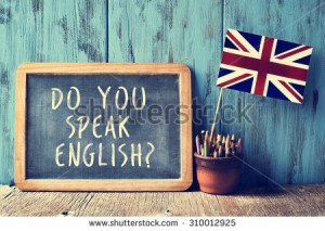 stock-photo-a-chalkboard-with-the-text-do-you-speak-english-written-in-it-a-pot-with-pencils-and-the-flag-of-310012925